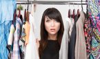 Portrait Of Young Confused Woman In Front Of A Wardrobe