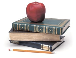 books, pencil, apple on white