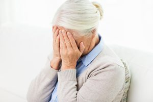 health care, pain, stress, age and people concept - senior woman